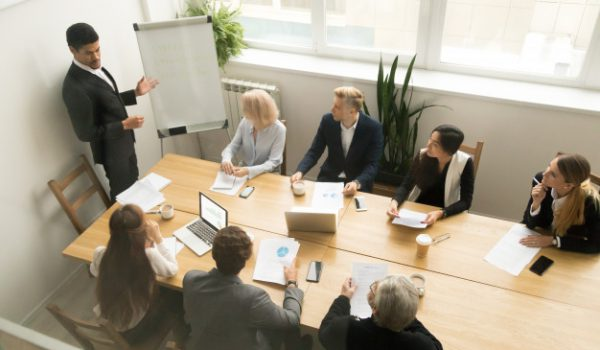 african-american-ceo-giving-presentation-corporate-team-meeting-concept_1163-4880