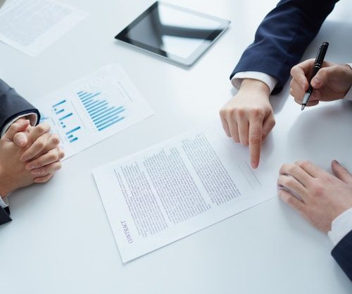 top-view-businessman-signing-documents_1098-3387